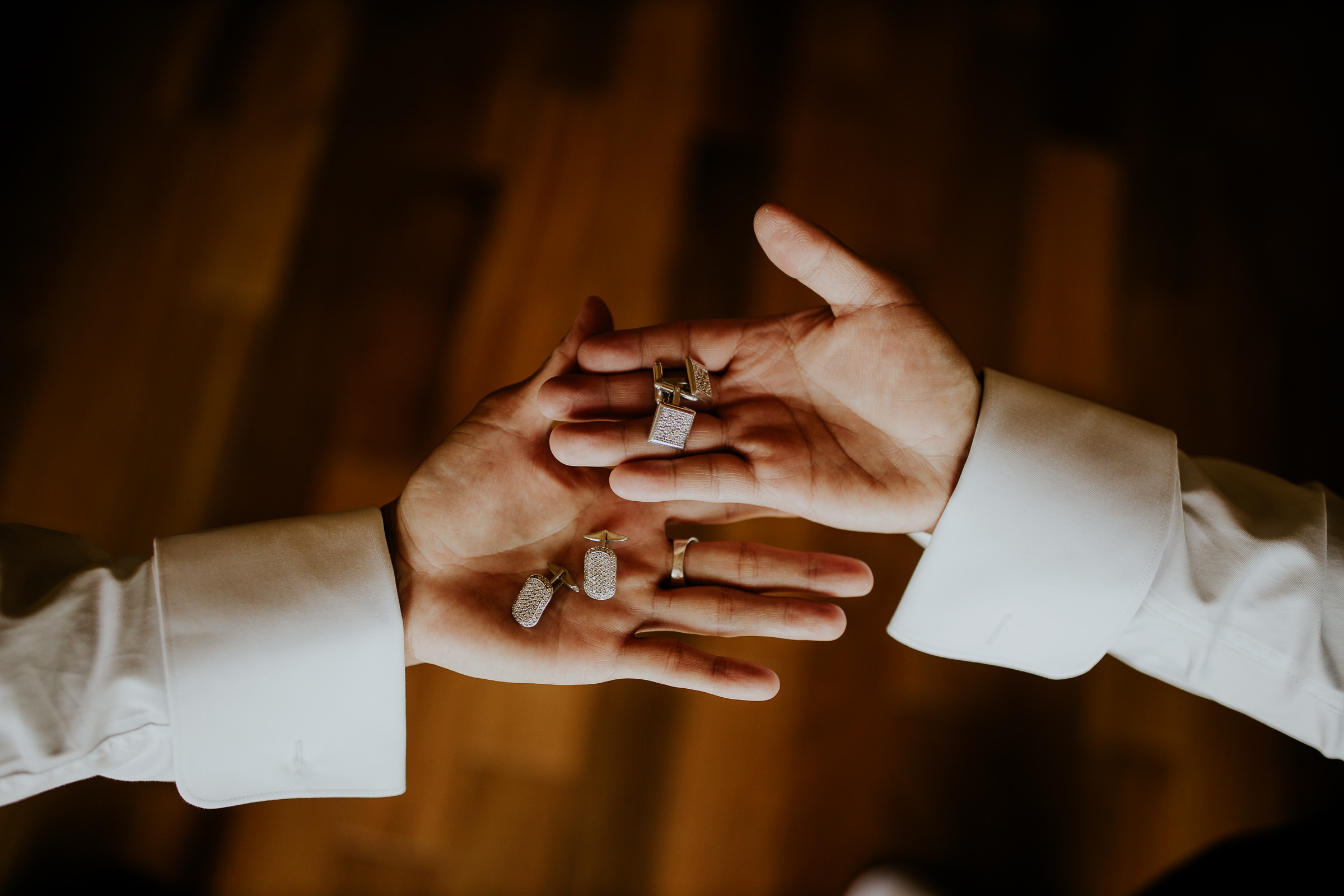 hands with wedding accessories
