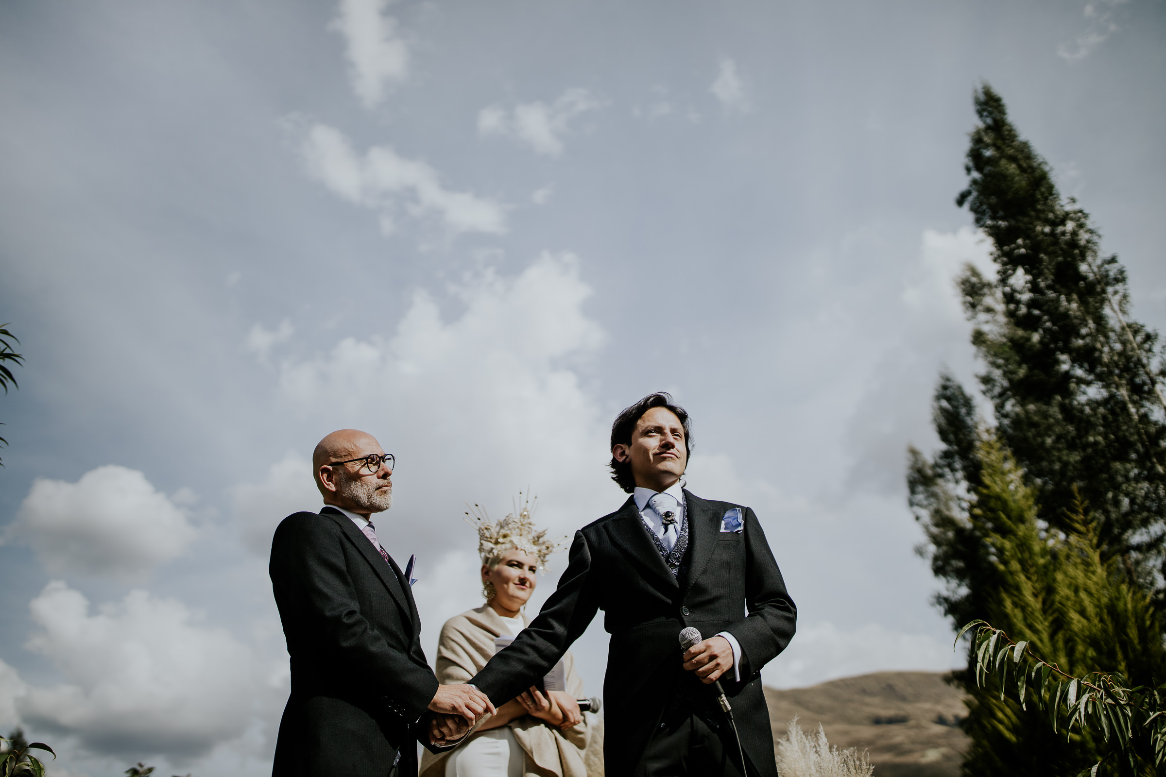 two men getting married in a peruvian ceremony
