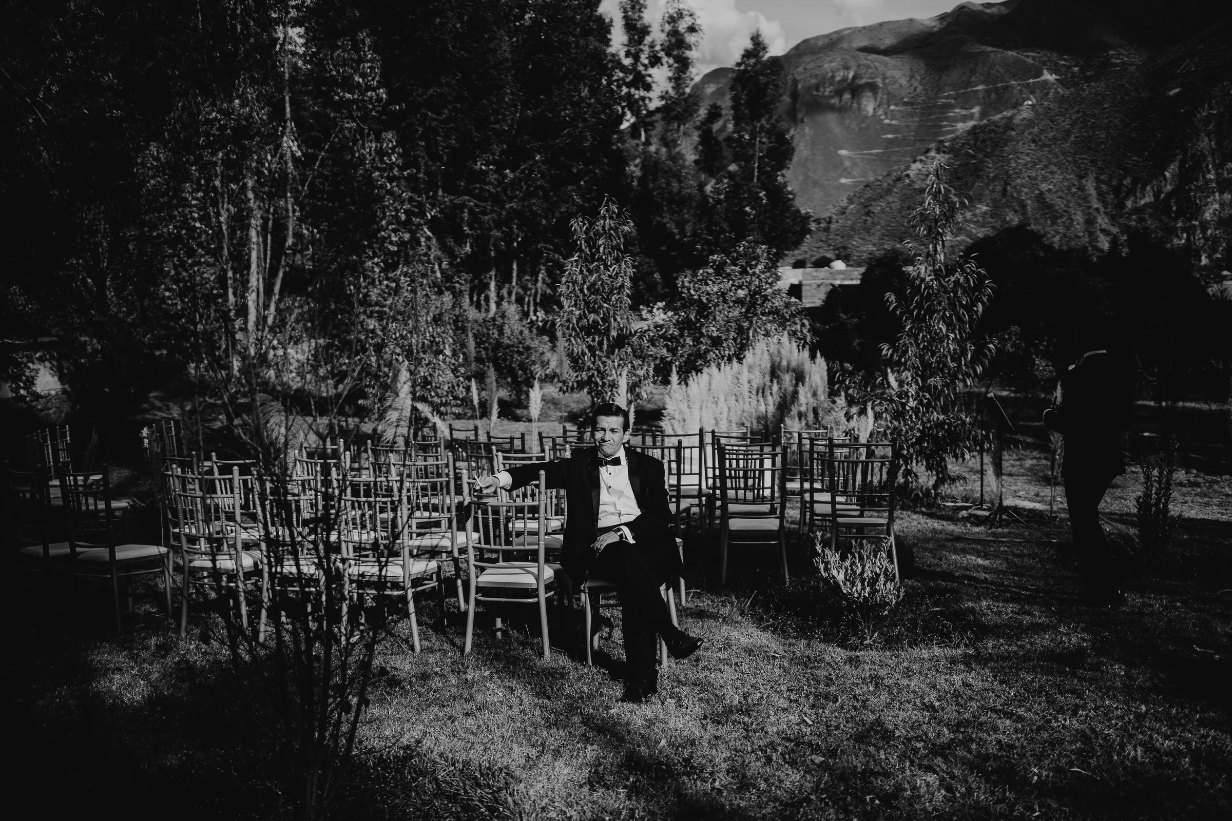 man sitting alone at a wedding ceremony set up