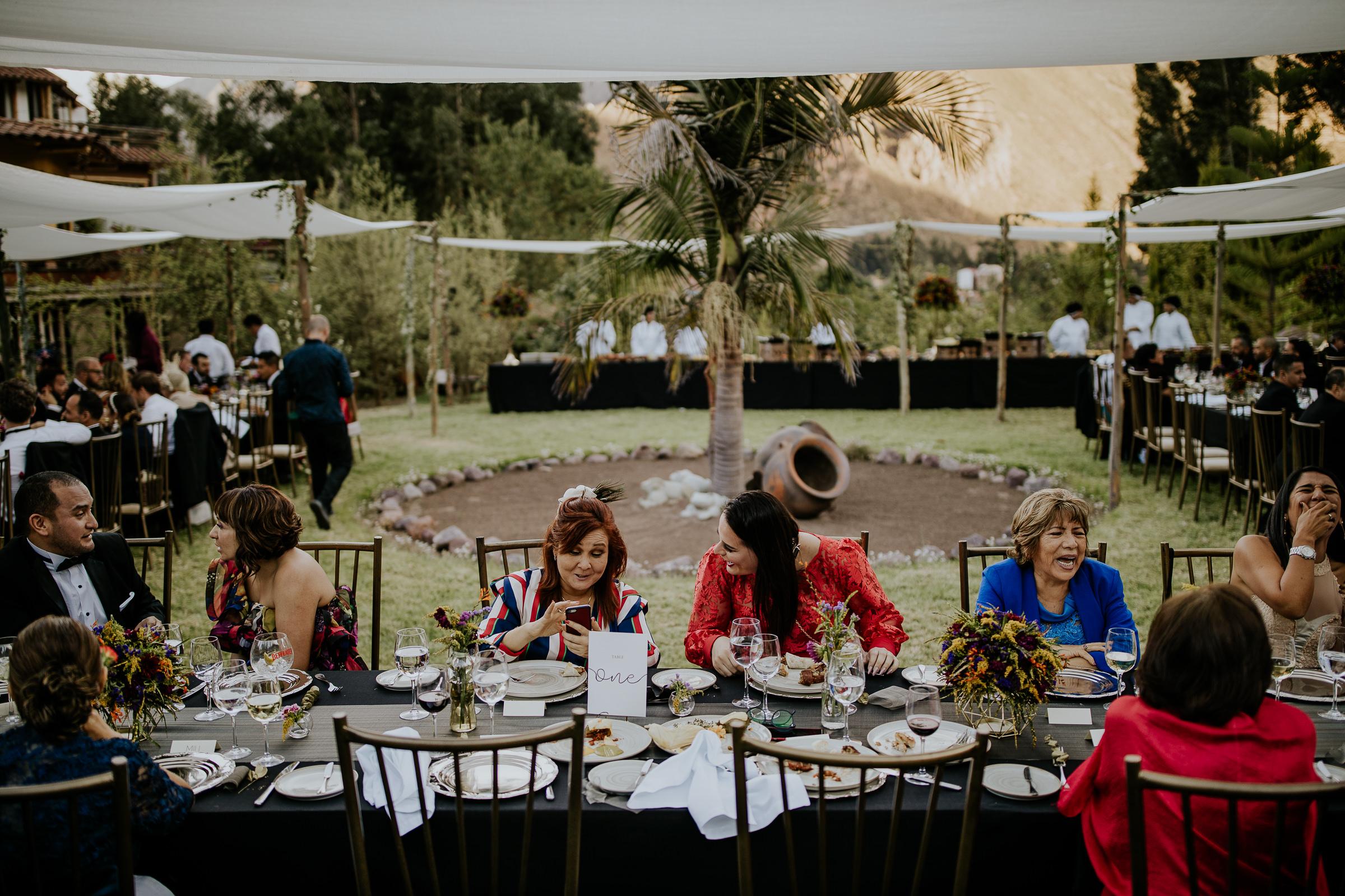 wedding ghuests sitting on dinner tables