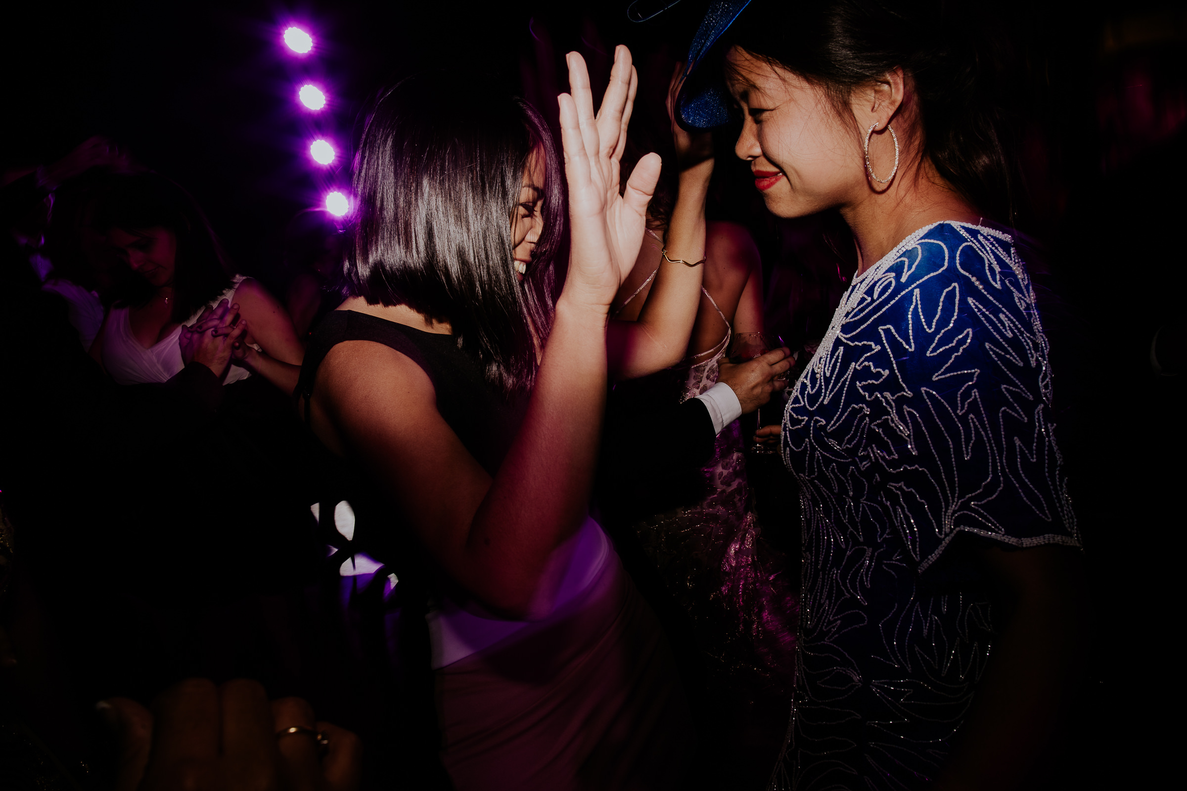 two women dancing at a wedding party