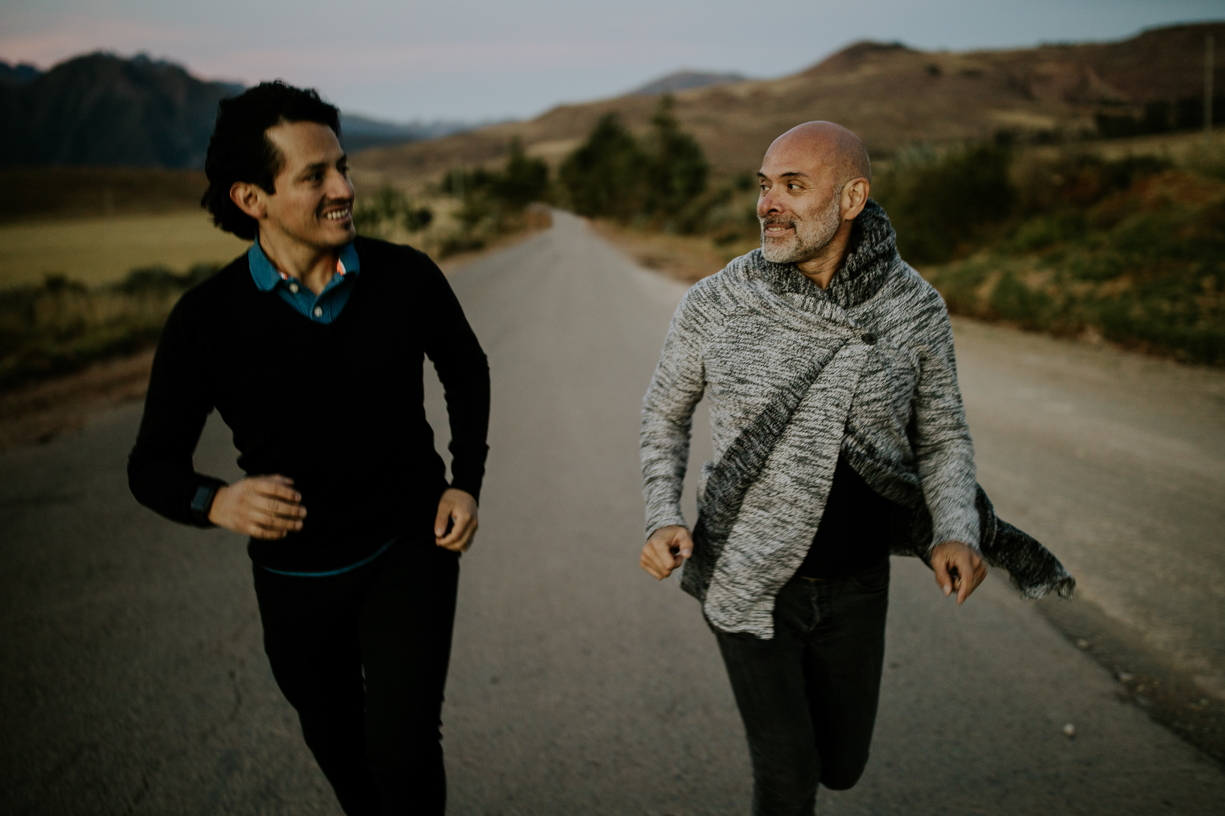 two men running on the road