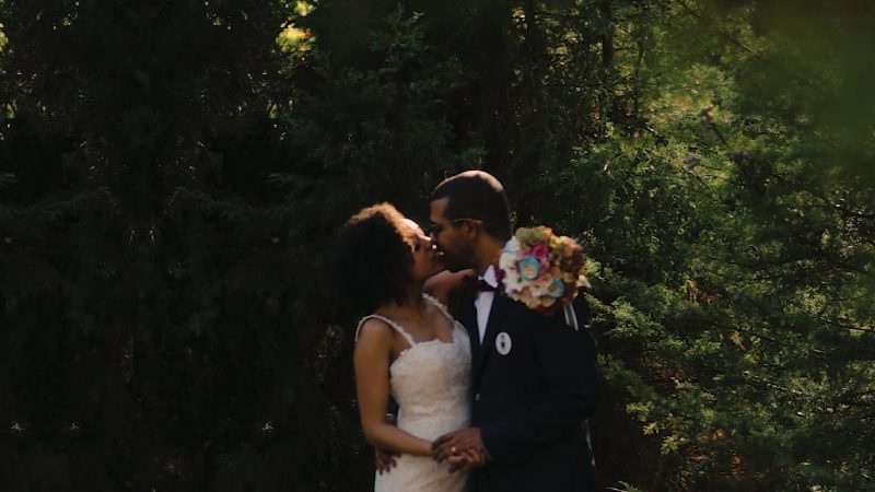 bride and groom embracing in the woods