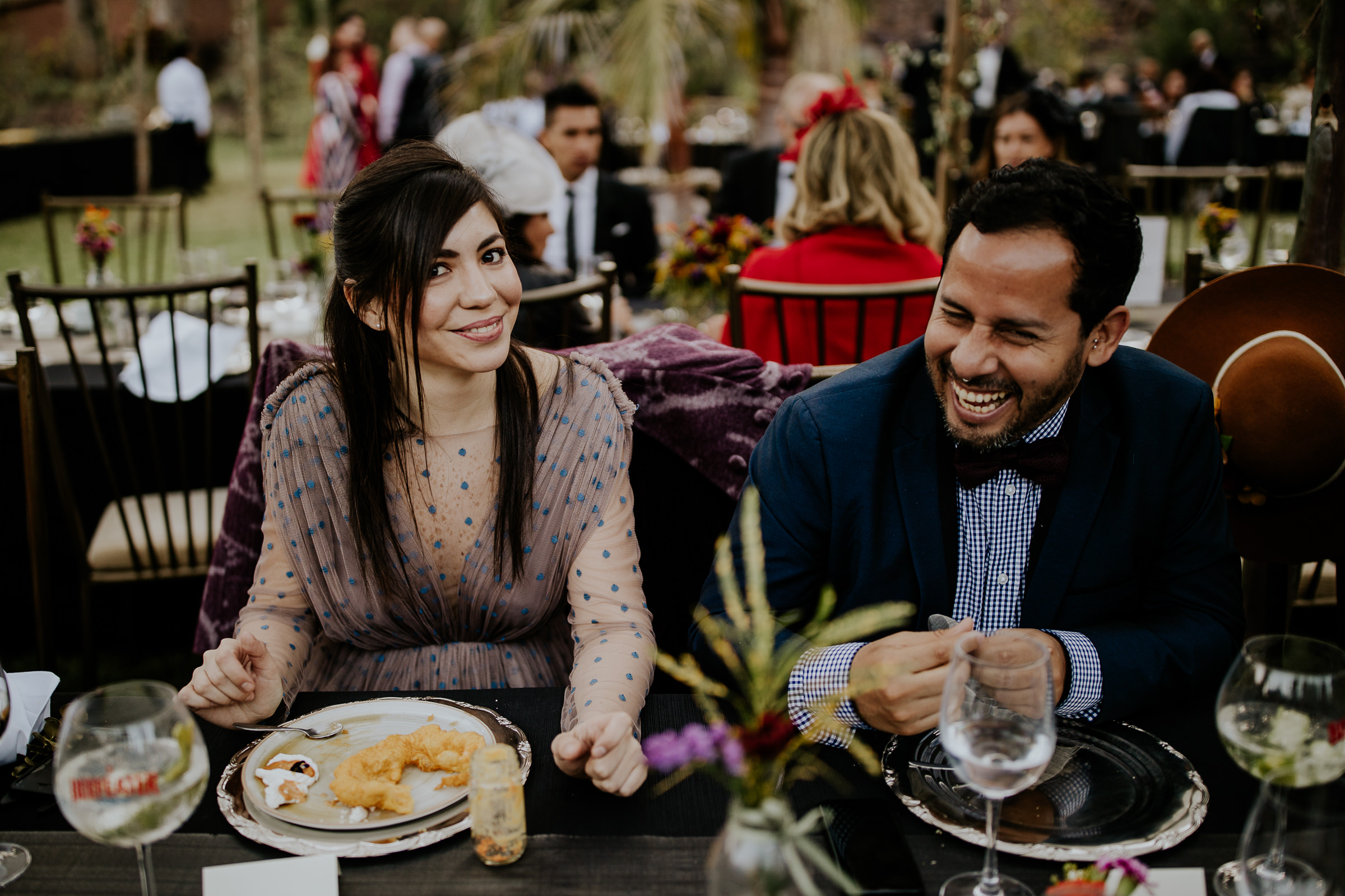 man and woman smiling at the camera during the dinner